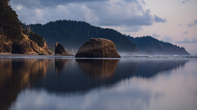 reflection of rock formations on the oregon coast