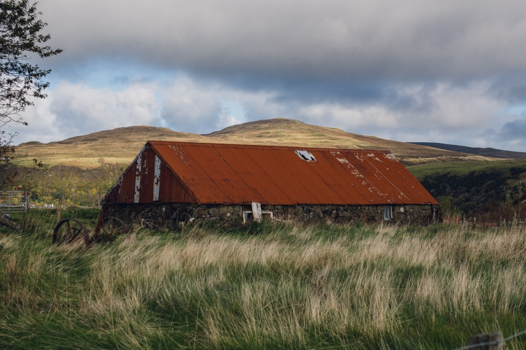 red roof barn in tall grass on the isle of skye