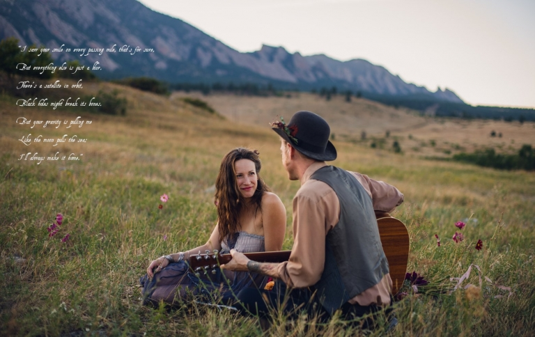 bohemian boulder couple on a picnic date in the mountains