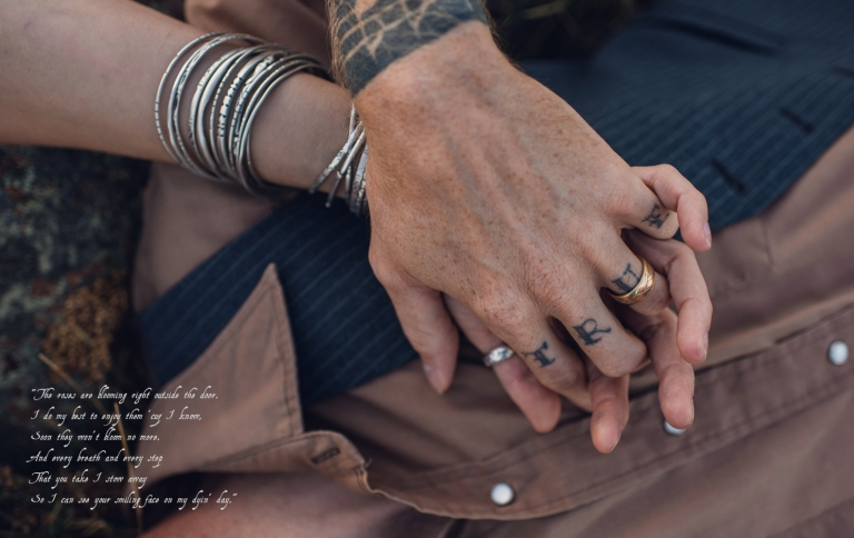 tattooed couple holding hands