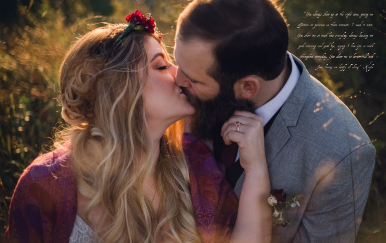 couple kisses in golden grass at sunset after their intimate elopement